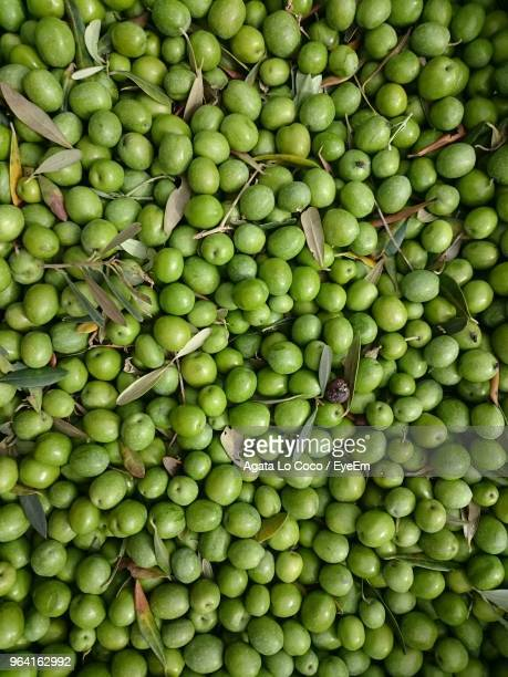 full frame shot of green olives for sale at market - green olive stock photos and pictures
