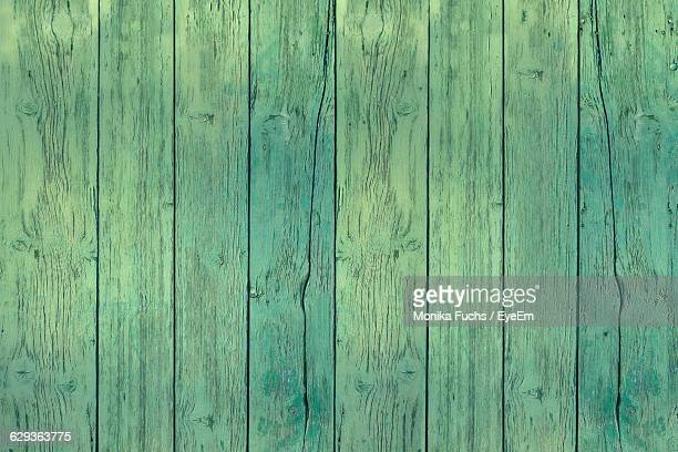 full frame shot of green wooden wall - green wood stock pictures, royalty-free photos & images