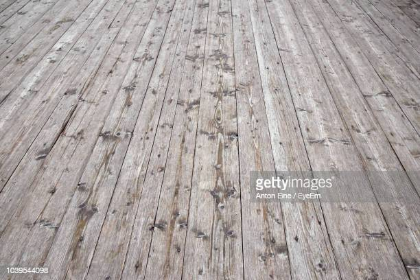 full frame shot of hardwood floor - floorboard stock photos and pictures