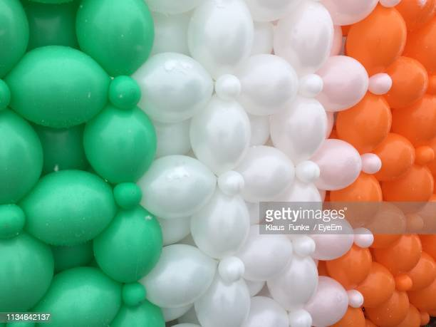 full frame shot of helium balloons during st patricks day - st patricks background stock pictures, royalty-free photos & images