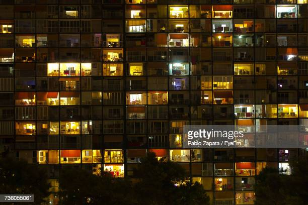 full frame shot of illuminated building at night - building story stock pictures, royalty-free photos & images