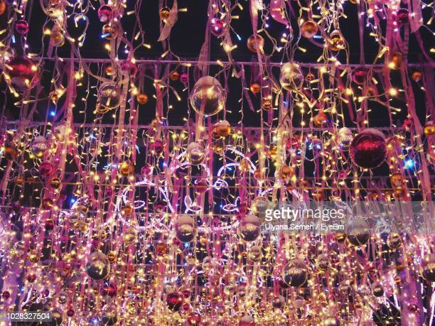 full frame shot of illuminated christmas decorations at night - christmas background stock photos and pictures