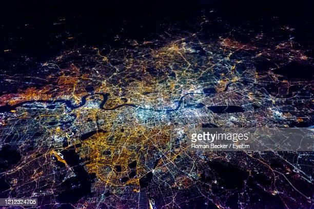 full frame shot of illuminated city against sky at night - london england stock pictures, royalty-free photos & images