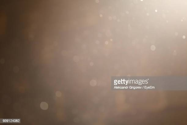 full frame shot of illuminated defocused lights - dust stock pictures, royalty-free photos & images
