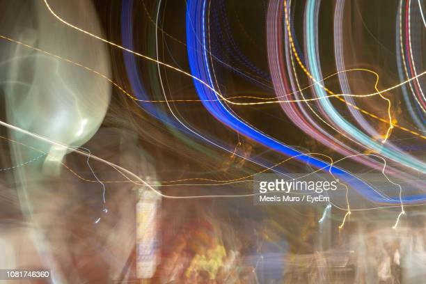 full frame shot of illuminated light trails at night - muro stock photos and pictures