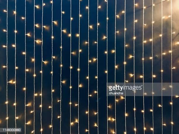 full frame shot of illuminated string lights at night - ストリングライト ストックフォトと画像