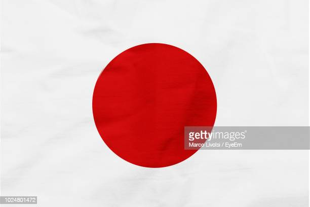 full frame shot of japanese flag - japanese flag stock photos and pictures