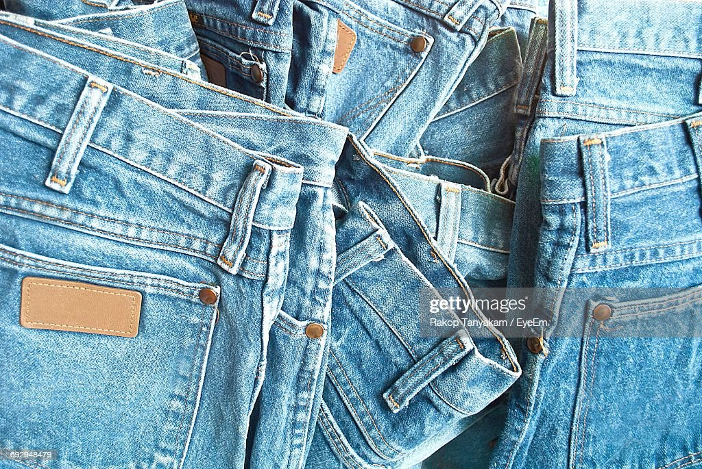 Full Frame Shot Of Jeans For Sale At Market Stall : Stock Photo