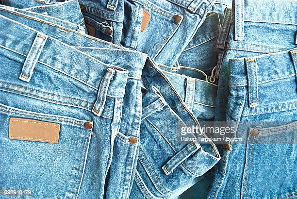 full frame shot of jeans for sale at market stall - spijkerbroek stockfoto's en -beelden