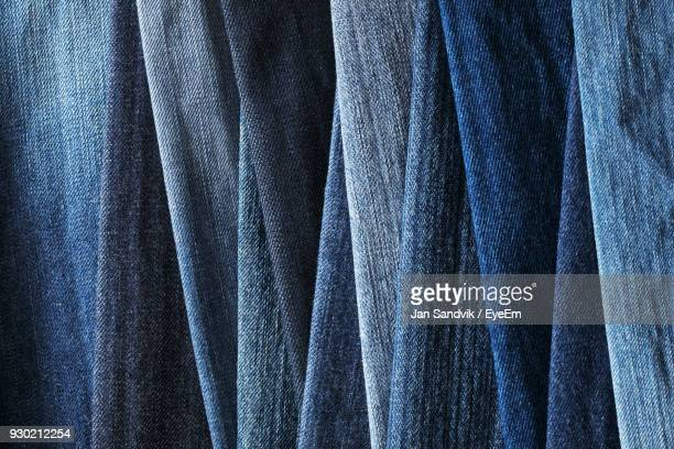 full frame shot of jeans for sale - denim stock pictures, royalty-free photos & images