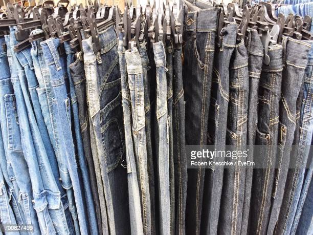 Full Frame Shot Of Jeans Hanging For Sale At Store
