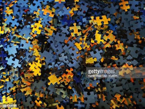 full frame shot of jigsaw pieces - jigsaw piece stock pictures, royalty-free photos & images