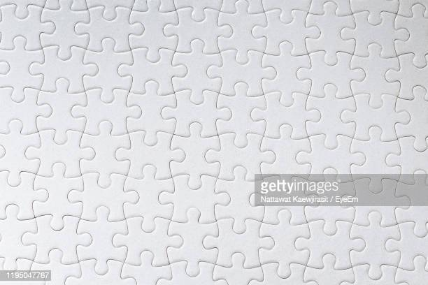 full frame shot of jigsaw puzzle - puzzle stock pictures, royalty-free photos & images
