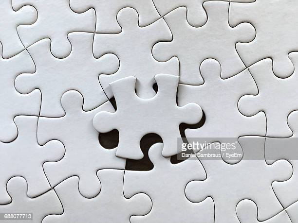 full frame shot of jigsaw puzzle - raadsel stockfoto's en -beelden