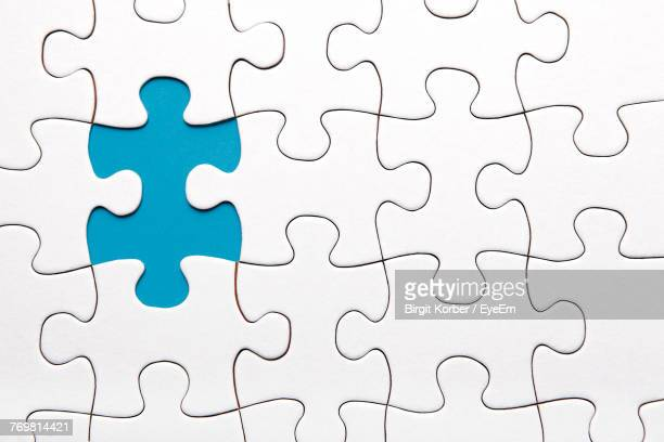 full frame shot of jigsaw puzzle - incomplete stock pictures, royalty-free photos & images