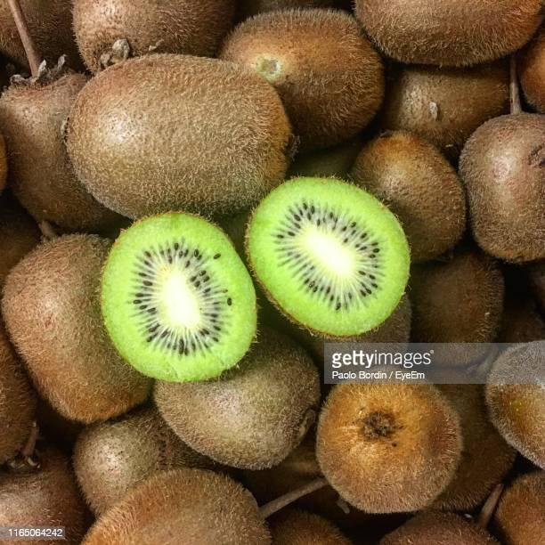 full frame shot of kiwi for sale - kiwi fruit stock pictures, royalty-free photos & images