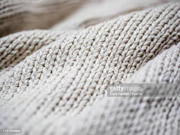 full frame shot of knitted fabric - knitted stock pictures, royalty-free photos & images