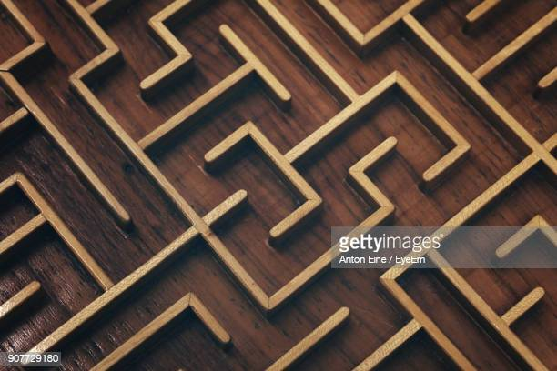 full frame shot of labyrinth wood - maze stock photos and pictures
