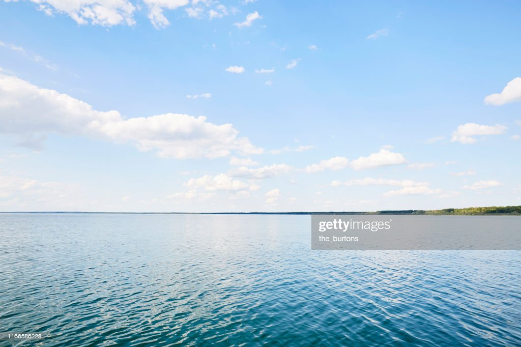 Full frame shot of lake, clouds and blue sky, backgrounds : Stock Photo