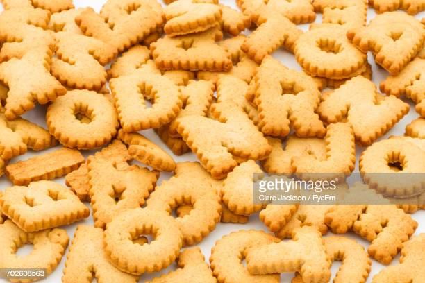 full frame shot of letter-shaped cookies - capital letter stock pictures, royalty-free photos & images