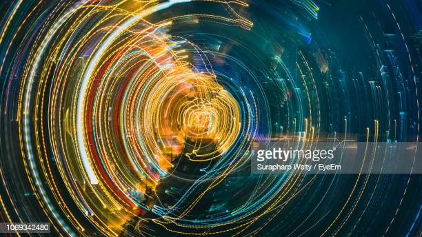 full frame shot of light trails at night - concentric stock pictures, royalty-free photos & images