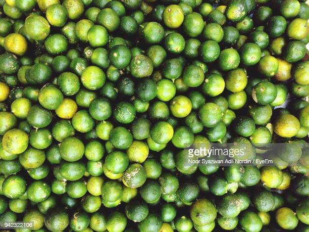 Full Frame Shot Of Limes For Sale At Market