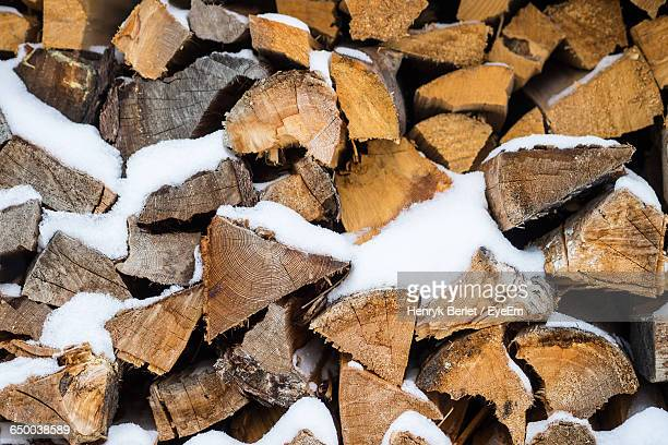 Full Frame Shot Of Logs With Snow During Winter