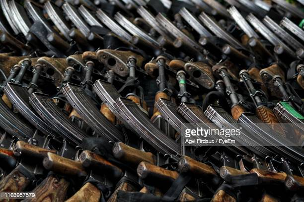 full frame shot of machine guns - machine gun stock pictures, royalty-free photos & images