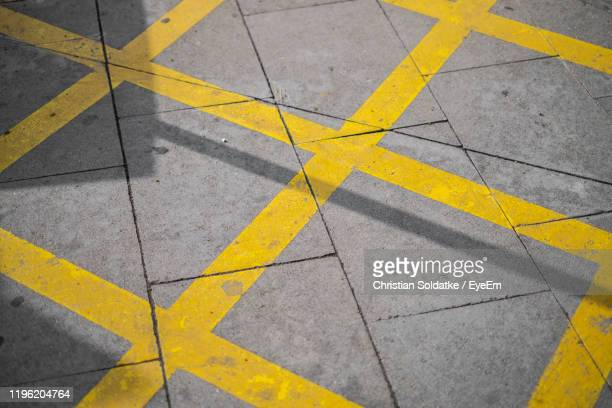 full frame shot of markings on footpath - christian soldatke stock pictures, royalty-free photos & images