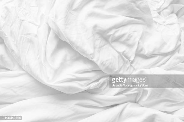 full frame shot of messy bed - sheet stock pictures, royalty-free photos & images