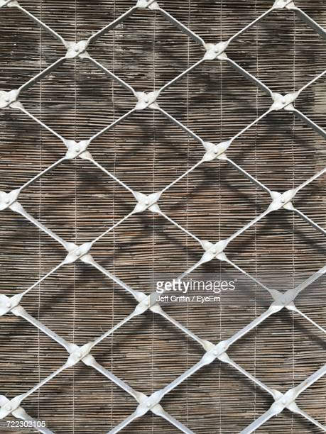 full frame shot of metal grate by curtain on window - metal grate ストックフォトと画像