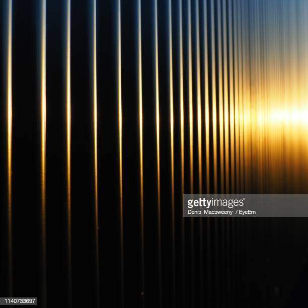 full frame shot of metal grate - gold metal stock pictures, royalty-free photos & images
