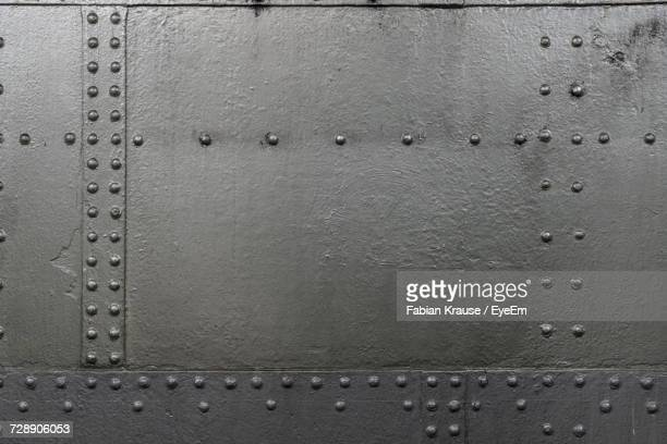 full frame shot of metal wall - metallic stock photos and pictures