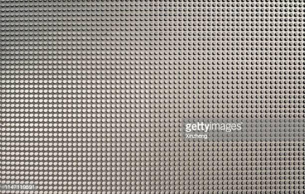 full frame shot of metallic structure - irregular texturizado fotografías e imágenes de stock