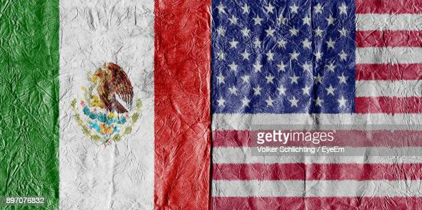 full frame shot of mexican and american flags - bandera mexicana fotografías e imágenes de stock