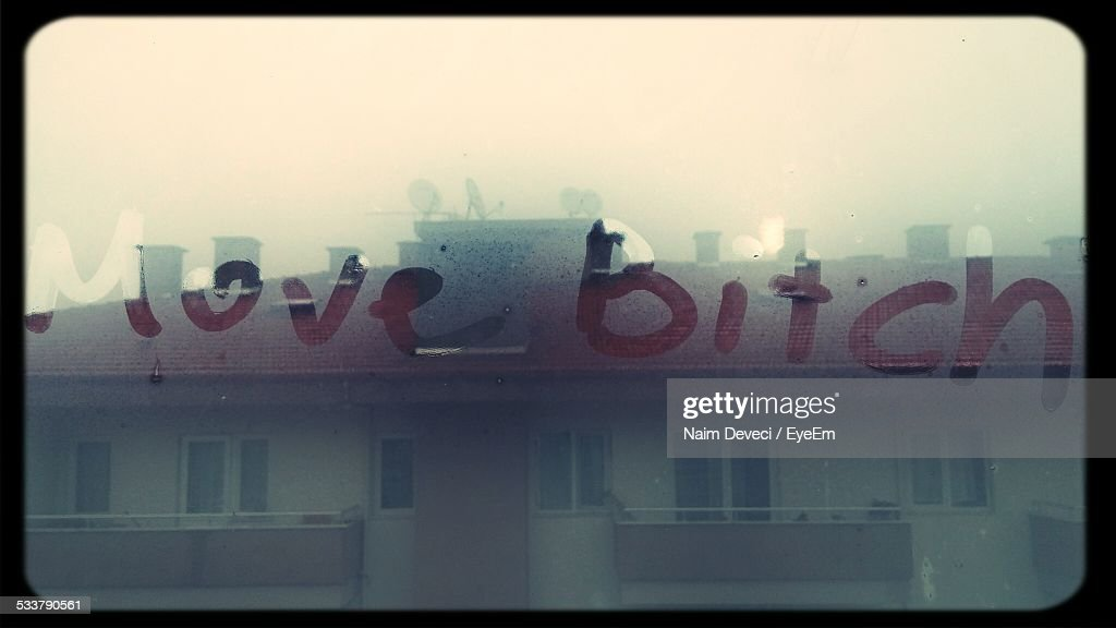 Full Frame Shot Of Move Bitch Written On Condensed Glass : Foto stock