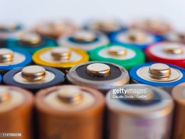 full frame shot of multi colored batteries - alkaline stock pictures, royalty-free photos & images