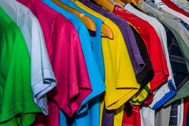 Full Frame Shot Of Multi Colored Clothes Hanging On Rack At Store