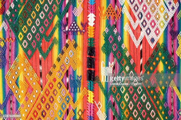 full frame shot of multi colored decoration hanging at market - guatemala stock pictures, royalty-free photos & images