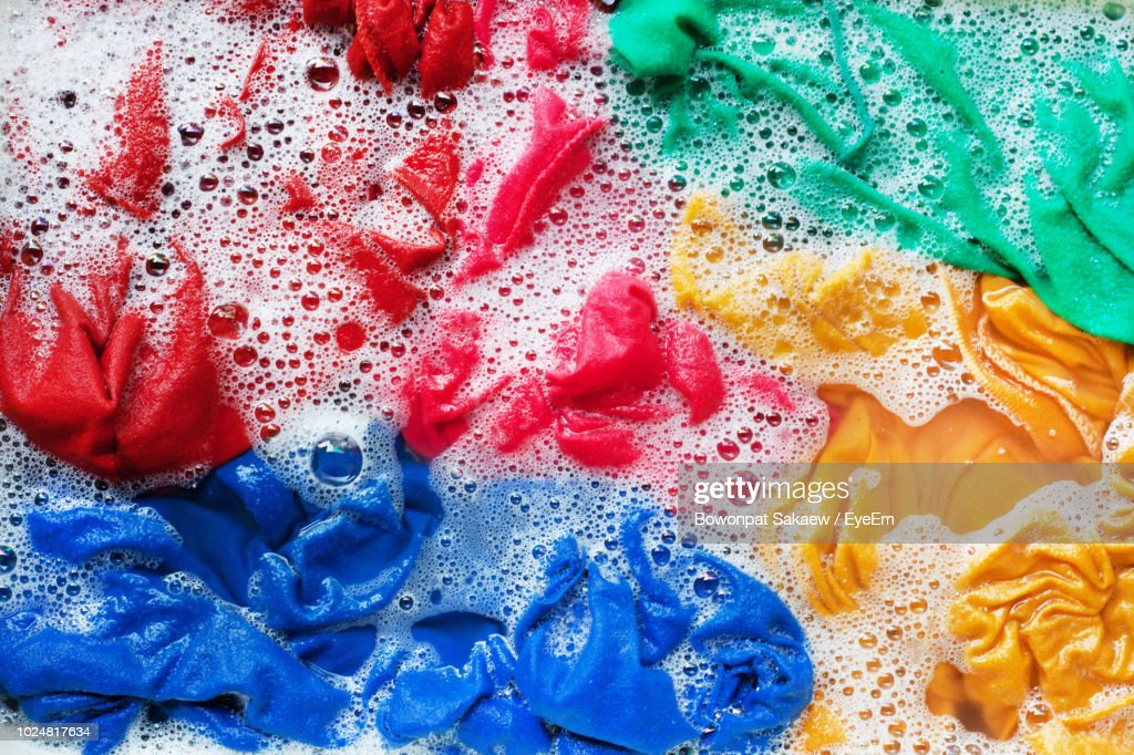 Full Frame Shot Of Multi Colored Fabric In Soap Sud : Stock Photo
