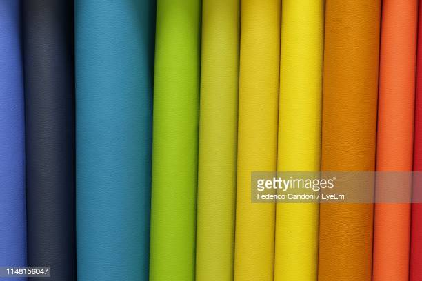 full frame shot of multi colored fabric - wallpaper roll stock pictures, royalty-free photos & images