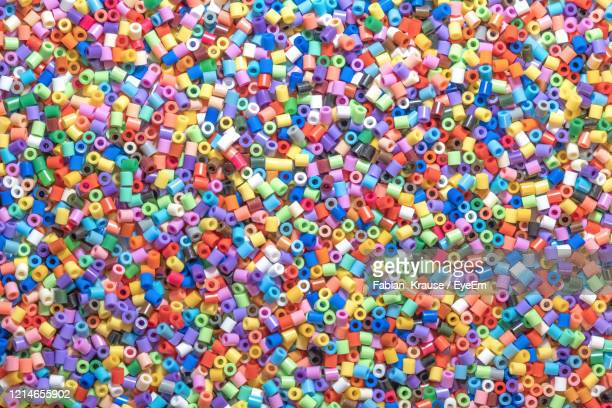 full frame shot of multi colored iron-on beads - bead stock pictures, royalty-free photos & images
