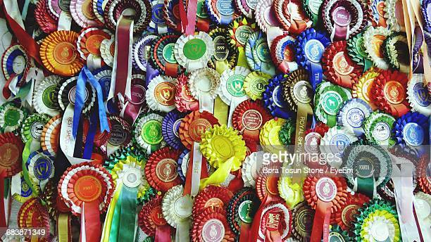 full frame shot of multi colored medals - awards stock photos and pictures