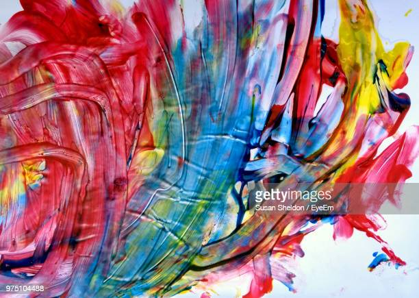 full frame shot of multi colored paints against white background - finger painting stock pictures, royalty-free photos & images