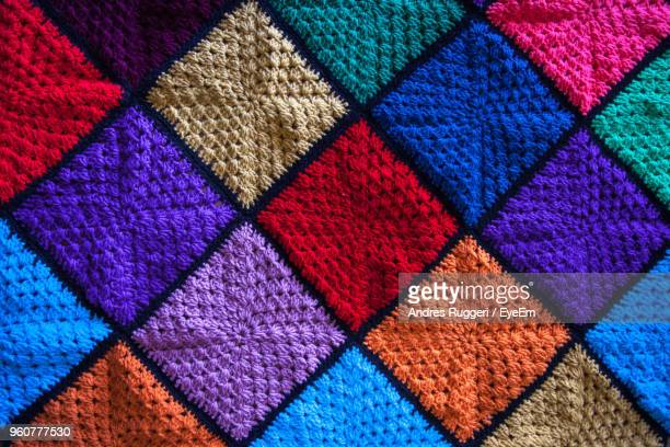 full frame shot of multi colored patterned woolen textile - knitted stock pictures, royalty-free photos & images