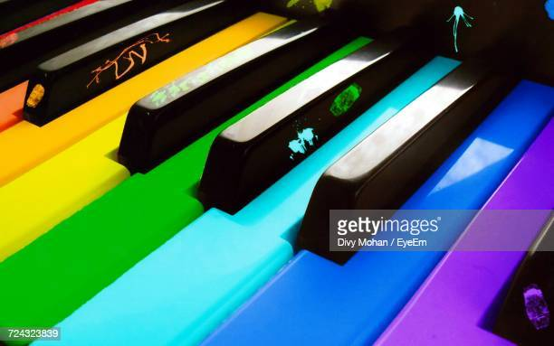 full frame shot of multi colored piano keys - piano key stock photos and pictures