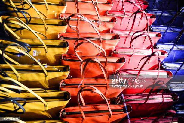 full frame shot of multi colored purses for sale in store - multi coloured purse stock photos and pictures