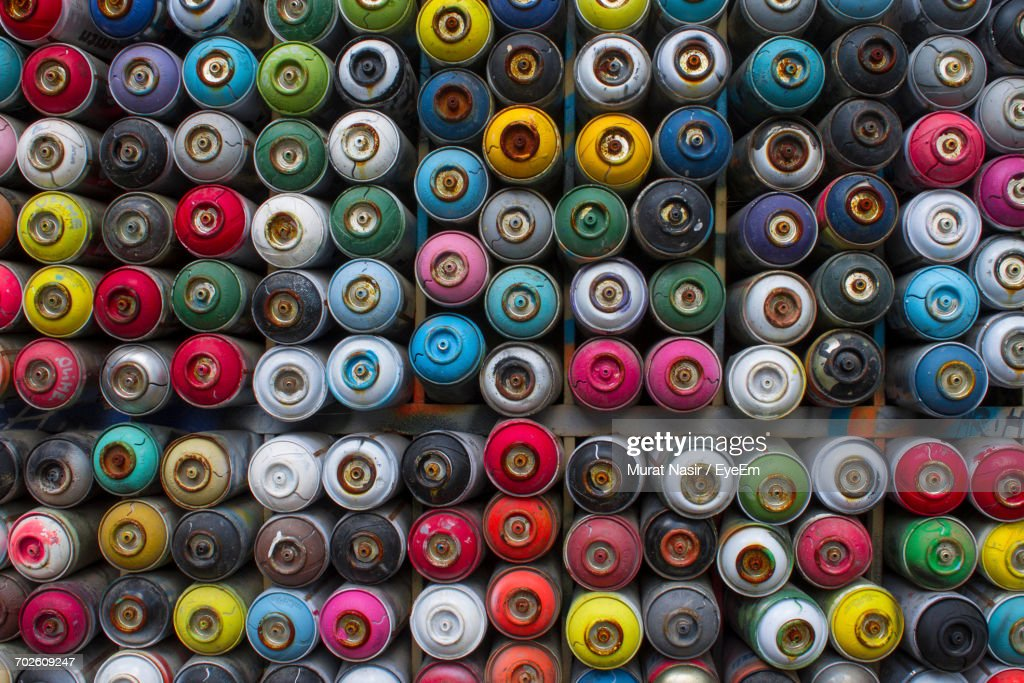 Full Frame Shot Of Multi Colored Spray Paint Cans Stock Photo