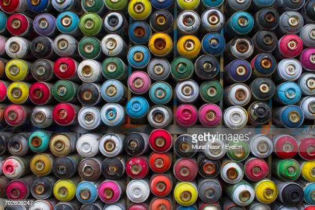 Full Frame Shot Of Multi Colored Spray Paint Cans