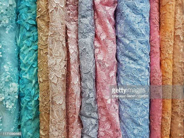 full frame shot of multi colored textiles - chanayut stock photos and pictures